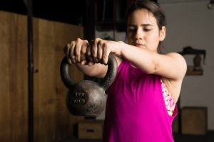 Woman struggling with kettlebell